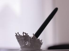 Держатель для ручки в виде всплесков воды