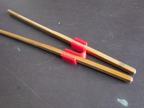 Тренажор для китайских палочек