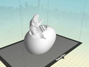 Детеныш тиранозавра в яйце